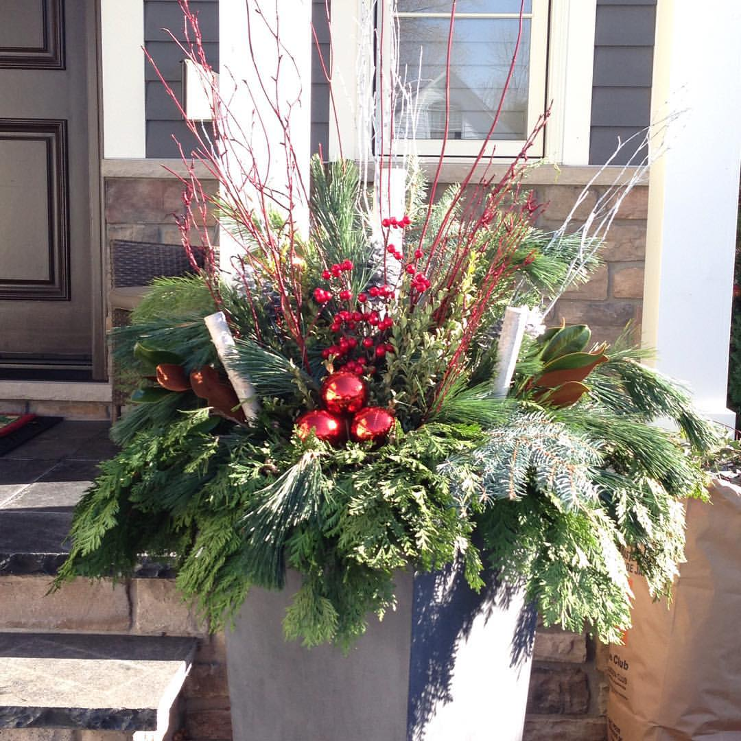 Holiday Home Staging Tips: Outdoor Christmas Flower Pot Arrangements.  Interior Design Lighting Tips